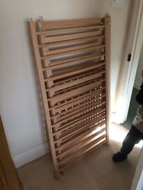 Child's cot with mattress.