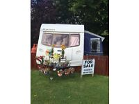 Sited 4 berth tourer pitched on small private site - fixed bed, within minutes from amenities