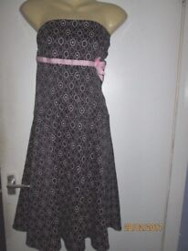 BLACK STRAPLESS DRESS WITH P[INK CIRCLE PATTERN BY LIPSY SIZE S/M ABOUT A SIZE 8