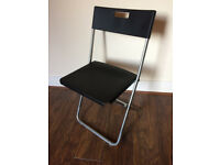 2 x black Gunde Ikea folding chairs
