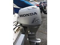 Honda 4 stroke 25hp Outboard Motor complete with Honda Remotes