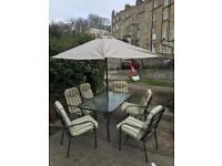 6 seater provence glass top garden table with detachable parasol