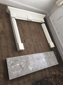 Grey marble hearth and white surround