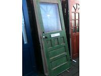 Vintage exterior hardwood door with glass panel