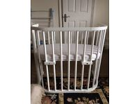 Never been used Babybay Convertible including mattress, sheet and detachable side rail in white.