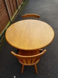 Pine Table with 2 chairs. Round. 100cm diameter.