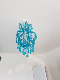 Teal chandelier from next still in good condition