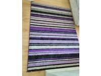 Purple rug with glitter