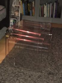 Nest of transparent acrylic tables