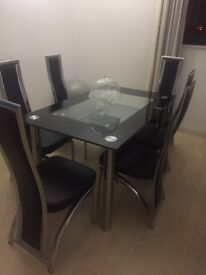 Lovely glass dining table & 6 leather chairs