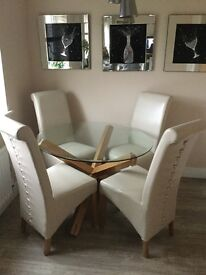 Circular glass table with oak legs & 4 cream leather chairs