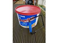 Tile adhesive ready mixed and tile saw