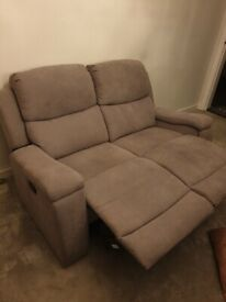 Grey recliner couches.