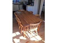 Pitch pine kitchen table with 8 chairs. All in excellent condition.