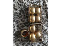 Gold coloured napkin ring holders