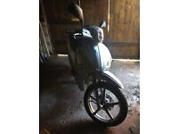 2013 Silver Piaggio Liberty Scooter. Mint Condition. Selling as impulse purchase - never ridden.