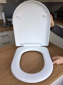 Two new white soft close toilet seats
