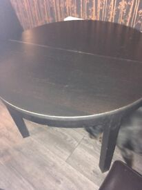 Black round extendable dining table