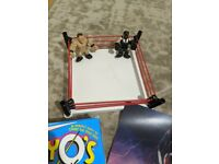 Small selection of WWE merchandise including WWE belt
