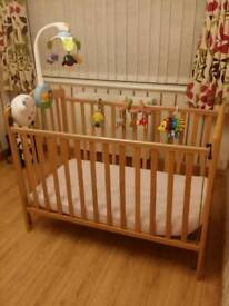 Infant Mamas&Papas Wooden bed with toys