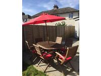 Outdoor table, six chairs with cushions and umbrella