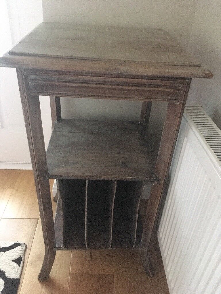 Attractive square topped wooden table