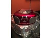 Brand new boxed Groove Boombox Stereo Radio and CD Player. Red and Black