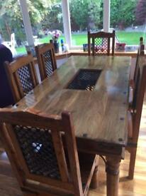 Solid wood dining table with six chairs