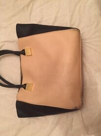 Beautiful ted baker bag good condition selling at a good price cream and black