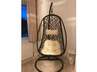 Comfortable hanging egg chair with cushions