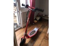 Razor E100 electric scooter red good condition fully charged and ready to go! Great fun