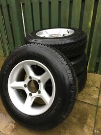 Set of 4 15 inch Alloy Wheels and tyres (months old) - Taken from a Suzuki Vitara 4x4 / off road