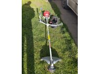 HONDA UMK435E FOUR STROKE PETROL STRIMMER AS NEW.