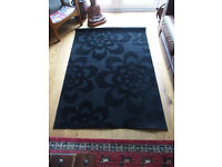 """2 Black patterned rugs - 1.7m (5'7"""") long, 1.2m (4') wide. £9 each or £15 for the two."""