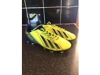 Two pairs of boys Adidas football boots, size 4
