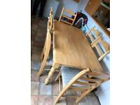 Dining room table and chairs ( SOLID PINE THE WRAPER STILL ON THE SEATS )