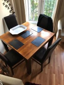 Bentley Designs Dark Wood (Walnut) Dining Table & 4 Faux Leather Chairs