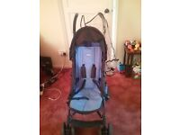 blue pushchair with rain cover,