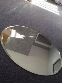 Oval mirror with clips