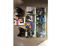 Xbox 360 with 120g hard drive, 2 controllers, wireless adapter and 9 games