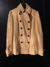 Marks and Spencer yellow jacket needs a steam !