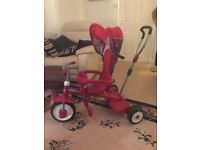 Radio Flyer 4 in 1 trrian kids trike, in good condition one small tear on rubber handle