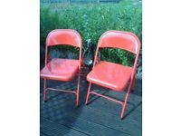 two metal retro style folding chairs