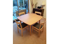 Ikea Extending Dining Table and 4 Padded Seat Chairs. All in good condition.
