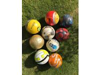 Selection of sports balls football basket ball rugby