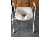 NEW unused. Multi Position Stand Alone Raised Toilet Seat