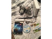 Nintendo wii with 3 games