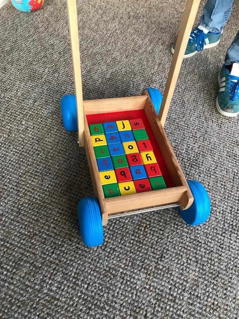 Wooden toy trolley of bricks