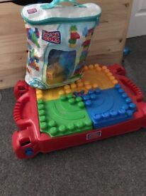 Mega blocks table and bag of bricks