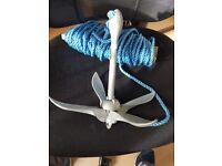 Small boat anchor plus neoprene rope.